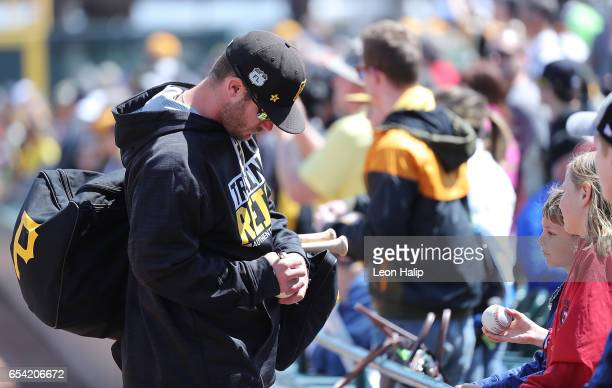 Joey Terdoslavich of the Pittsburgh Pirates signs autographs for the fans prior to the start of the Spring Training Game against the Baltimore...