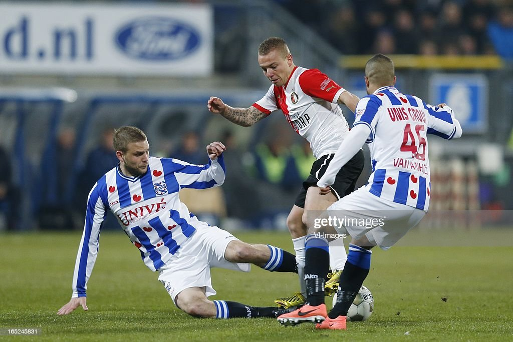 Joey van den Berg of Heerenveen,Jordy Clasie of Feyenoord,Pele van Anholt of Heerenveen during the Dutch Eredivisie match between SC Heerenveen and Feyenoord at the Abe Lenstra Stadium on march 30, 2013 in Heerenveen, The Netherlands
