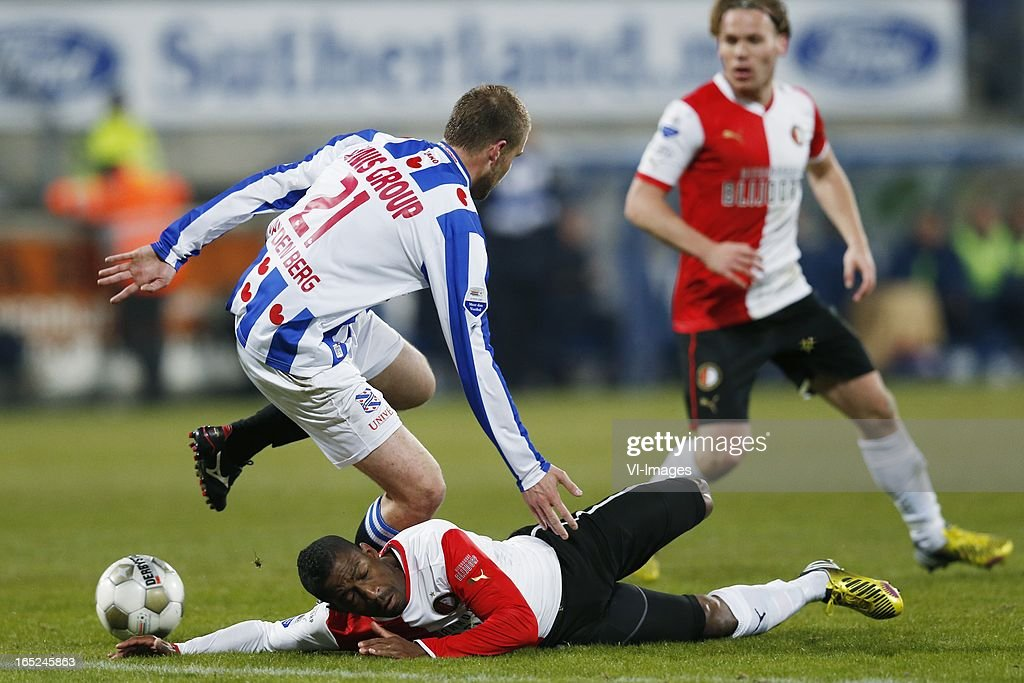Joey van den Berg of Heerenveen,Ruben Schaken of Feyenoord during the Dutch Eredivisie match between SC Heerenveen and Feyenoord at the Abe Lenstra Stadium on march 30, 2013 in Heerenveen, The Netherlands