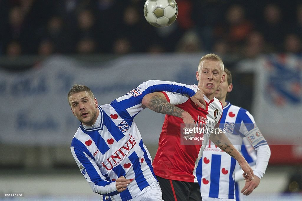 Joey van den Berg of SC Heerenveen, Lex Immers of Feyenoord during the Dutch Eredivisie match between SC Heerenveen and Feyenoord at the Abe Lenstra Stadium on march 30, 2013 in Heerenveen, The Netherlands