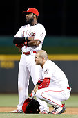 Joey Votto and Brandon Phillips of the Cincinnati Reds react during a pitching change against the St Louis Cardinals in the eighth inning of the game...