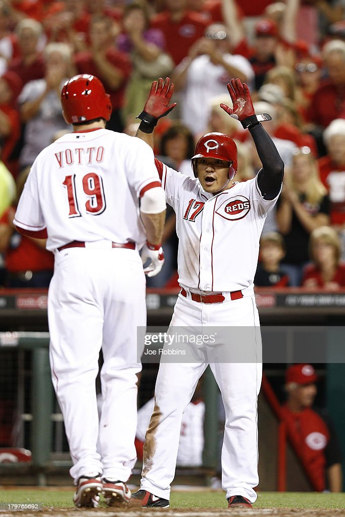 <a gi-track='captionPersonalityLinkClicked' href=/galleries/search?phrase=Joey+Votto&family=editorial&specificpeople=759319 ng-click='$event.stopPropagation()'>Joey Votto</a> #19 and <a gi-track='captionPersonalityLinkClicked' href=/galleries/search?phrase=Shin-Soo+Choo&family=editorial&specificpeople=196543 ng-click='$event.stopPropagation()'>Shin-Soo Choo</a> #17 of the Cincinnati Reds celebrate after Votto's two-run home run in the fifth inning of the game against the Los Angeles Dodgers at Great American Ball Park on September 6, 2013 in Cincinnati, Ohio. The Reds won 3-2.