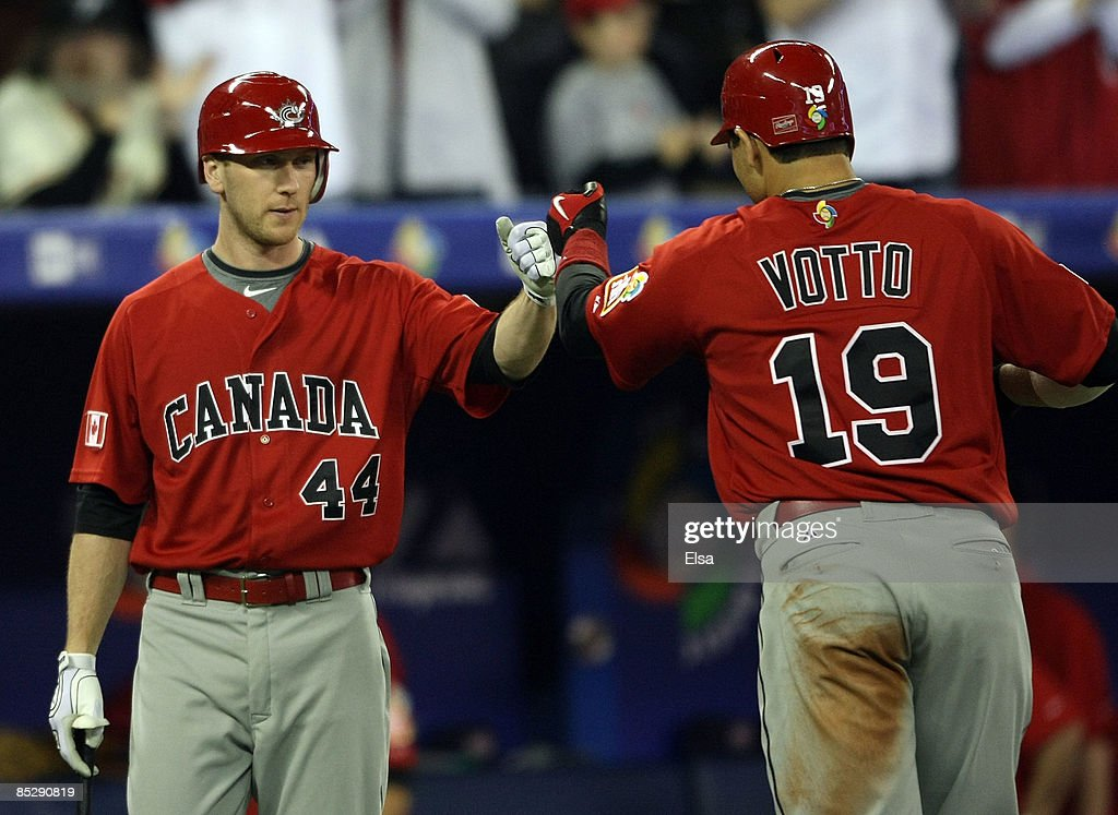 Joey Votto #19 of Canada is congratulated by teammate Jason Bay #44 after Votto hit a solo home run against the USA during the 2009 World Baseball Classic Pool C match on March 7, 2009 at the Rogers Center in Toronto, Ontario, Canada.