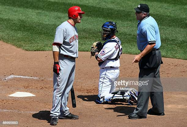Joey Votto of the Cincinnati Reds argues with home plate umpire Bill Welke after being called out on strikes against the New York Mets on July 12...