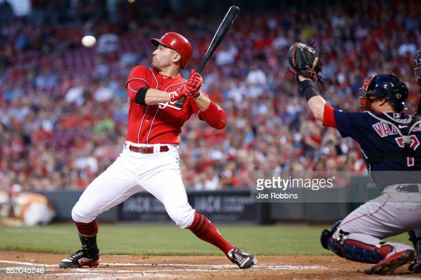 Joey Votto of the Cincinnati Reds backs away from an inside pitch in the first inning of a game against the Boston Red Sox at Great American Ball...