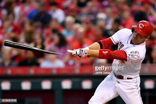 Joey Votto of the Cincinnati Reds breaks his bat on a single in the fourth inning against the San Diego Padres at Great American Ball Park on August...