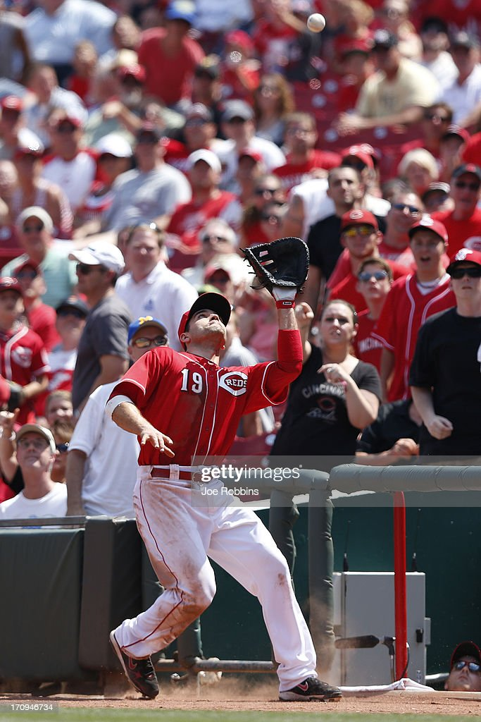<a gi-track='captionPersonalityLinkClicked' href=/galleries/search?phrase=Joey+Votto&family=editorial&specificpeople=759319 ng-click='$event.stopPropagation()'>Joey Votto</a> #19 of the Cincinnati Reds catches a foul ball against the Pittsburgh Pirates during the game at Great American Ball Park on June 20, 2013 in Cincinnati, Ohio. The Pirates won 5-3.