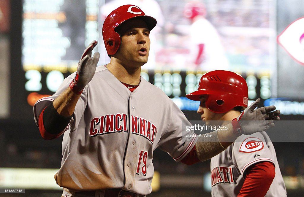 <a gi-track='captionPersonalityLinkClicked' href=/galleries/search?phrase=Joey+Votto&family=editorial&specificpeople=759319 ng-click='$event.stopPropagation()'>Joey Votto</a> #19 of the Cincinnati Reds celebrates after hitting a home run in the 10th inning against the Pittsburgh Pirates during the game on September 20, 2013 at PNC Park in Pittsburgh, Pennsylvania.