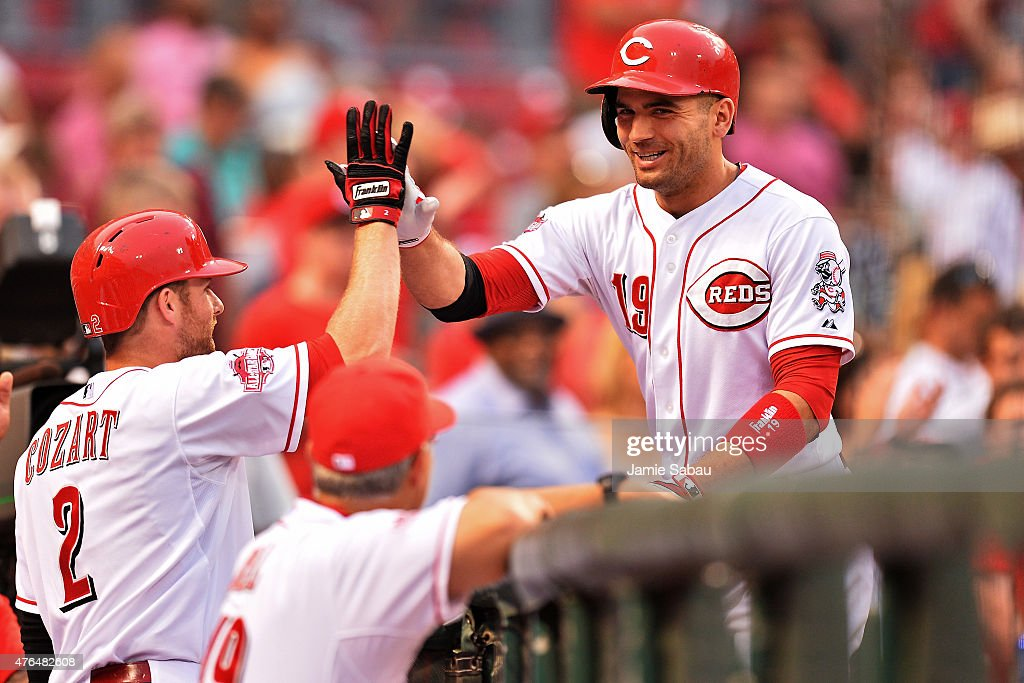 Joey Votto of the Cincinnati Reds celebrates his fifth inning solo home run against the Philadelphia Phillies with Zack Cozart of the Cincinnati Reds...