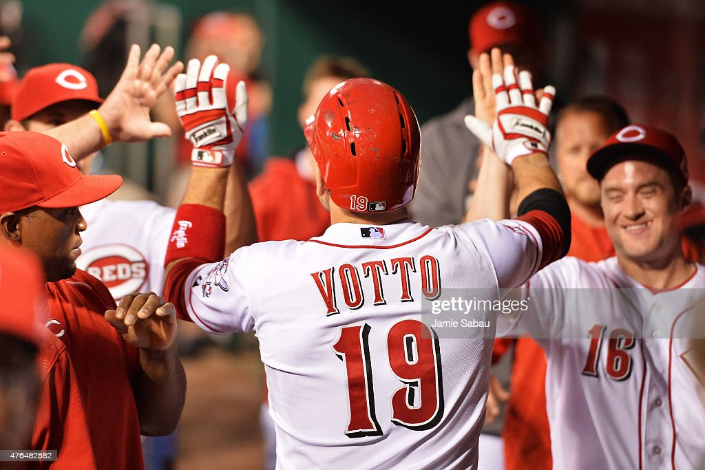 Joey Votto of the Cincinnati Reds celebrates his third home run of the game against the Philadelphia Phillies in the seventh inning at Great American...