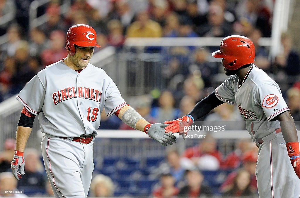 <a gi-track='captionPersonalityLinkClicked' href=/galleries/search?phrase=Joey+Votto&family=editorial&specificpeople=759319 ng-click='$event.stopPropagation()'>Joey Votto</a> #19 of the Cincinnati Reds celebrates with Brandon Phillips #4 after hitting a home run in the fourth inning against the Washington Nationals at Nationals Park on April 25, 2013 in Washington, DC.