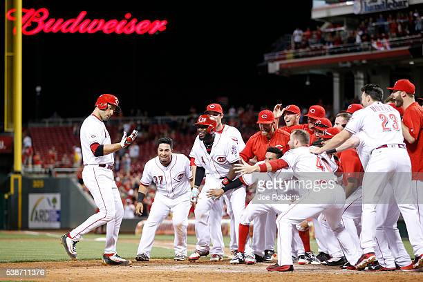 Joey Votto of the Cincinnati Reds celebrates with teammates after hitting the gamewinning home run against the St Louis Cardinals in the ninth inning...