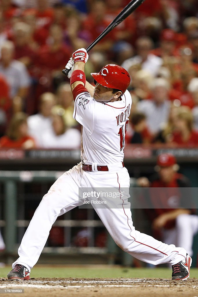 <a gi-track='captionPersonalityLinkClicked' href=/galleries/search?phrase=Joey+Votto&family=editorial&specificpeople=759319 ng-click='$event.stopPropagation()'>Joey Votto</a> #19 of the Cincinnati Reds hit a two-run home run in the fifth inning of the game against the Los Angeles Dodgers at Great American Ball Park on September 6, 2013 in Cincinnati, Ohio. The Reds won 3-2.