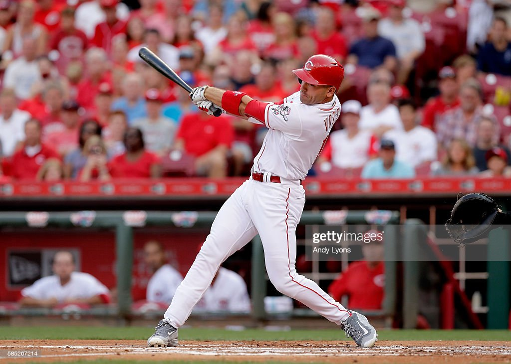 Joey Votto of the Cincinnati Reds hits a double to drive a run in the first inning against the St Louis Cardinals at Great American Ball Park on...