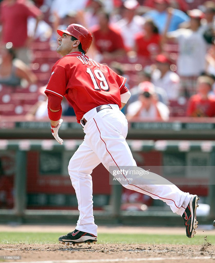 <a gi-track='captionPersonalityLinkClicked' href=/galleries/search?phrase=Joey+Votto&family=editorial&specificpeople=759319 ng-click='$event.stopPropagation()'>Joey Votto</a> #19 of the Cincinnati Reds hits a home run during the game against the New York Mets at Great American Ball Park on July 28, 2011 in Cincinnati, Ohio.