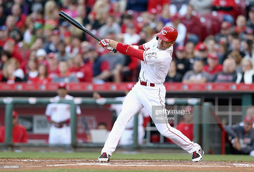 Joey Votto of the Cincinnati Reds hits a home run in the first inning against the St Louis Cardinals in the game at Great American Ball Park on April...