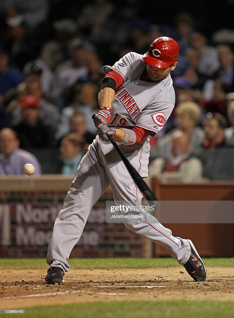 Joey Votto of the Cincinnati Reds hits a runscoring double in the 6th inning against the Chicago Cubs at Wrigley Field on September 6 2011 in Chicago...