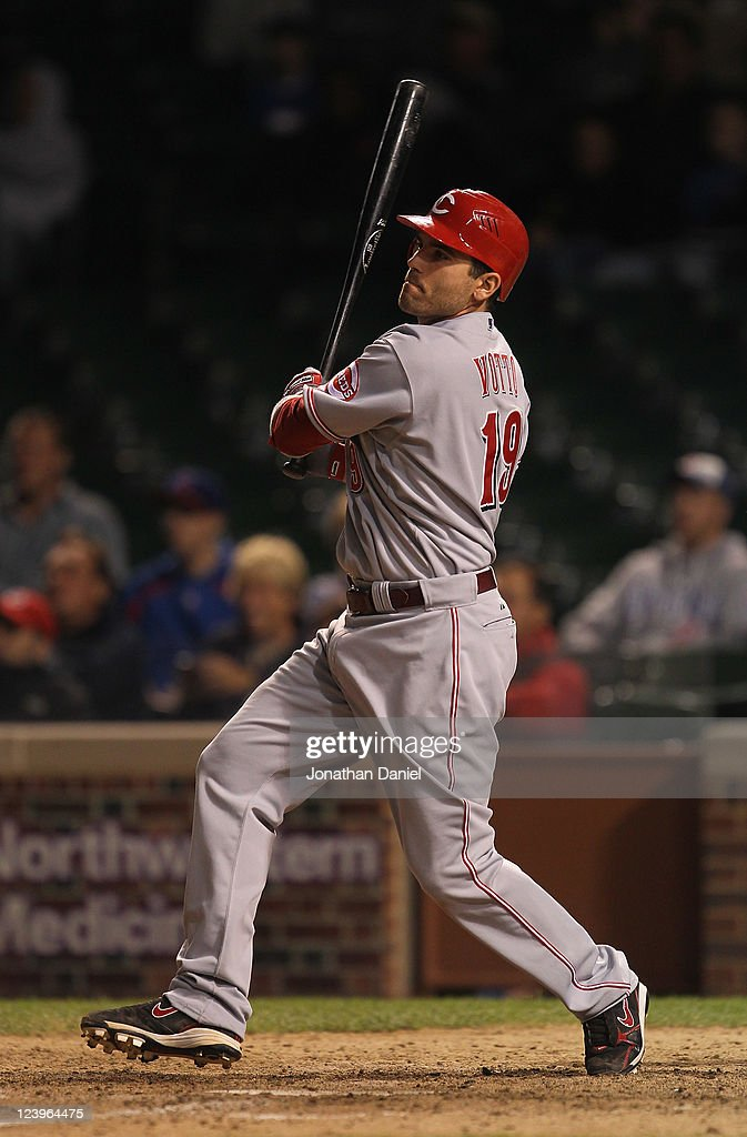 Joey Votto of the Cincinnati Reds hits a runscoring double in the 13th inning against the Chicago Cubs at Wrigley Field on September 6 2011 in...