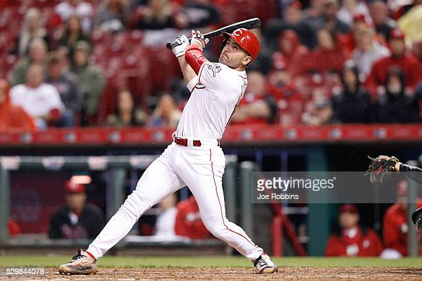 Joey Votto of the Cincinnati Reds hits a solo home run to left field to tie the game against the Pittsburgh Pirates in the sixth inning at Great...