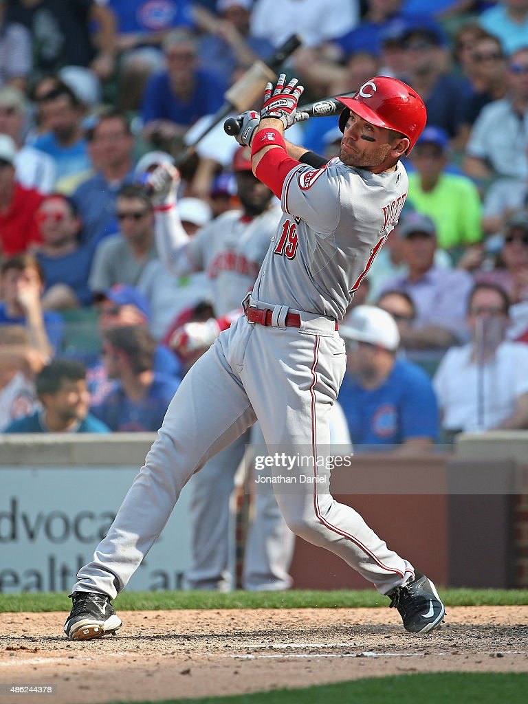 Joey Votto of the Cincinnati Reds hits a threerun home run in the 9th inning to beat the Chicago Cubs at Wrigley Field on September 2 2015 in Chicago...