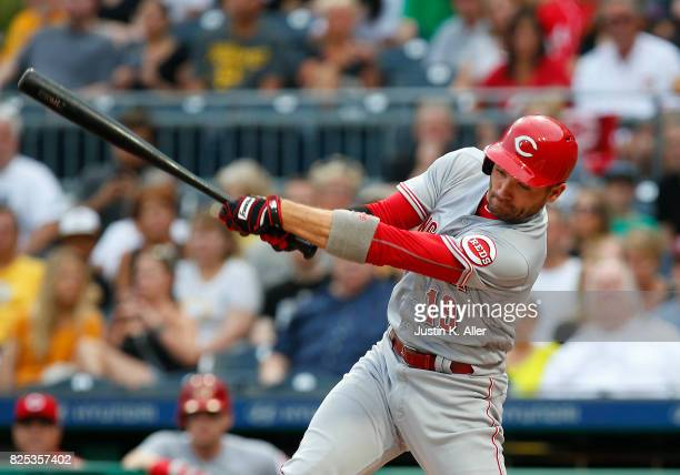 Joey Votto of the Cincinnati Reds hits into a fielder's choice scoring a run in the first inning against the Pittsburgh Pirates at PNC Park on August...