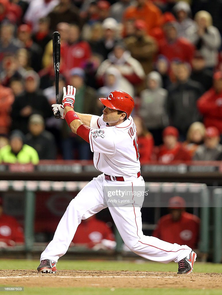 <a gi-track='captionPersonalityLinkClicked' href=/galleries/search?phrase=Joey+Votto&family=editorial&specificpeople=759319 ng-click='$event.stopPropagation()'>Joey Votto</a> #19 of the Cincinnati Reds hits the game winning single to drive in a run in the ninth inning against the Los Angeles Angels of Anaheim at Great American Ball Park on April 3, 2013 in Cincinnati, Ohio. The Reds won 5-4.