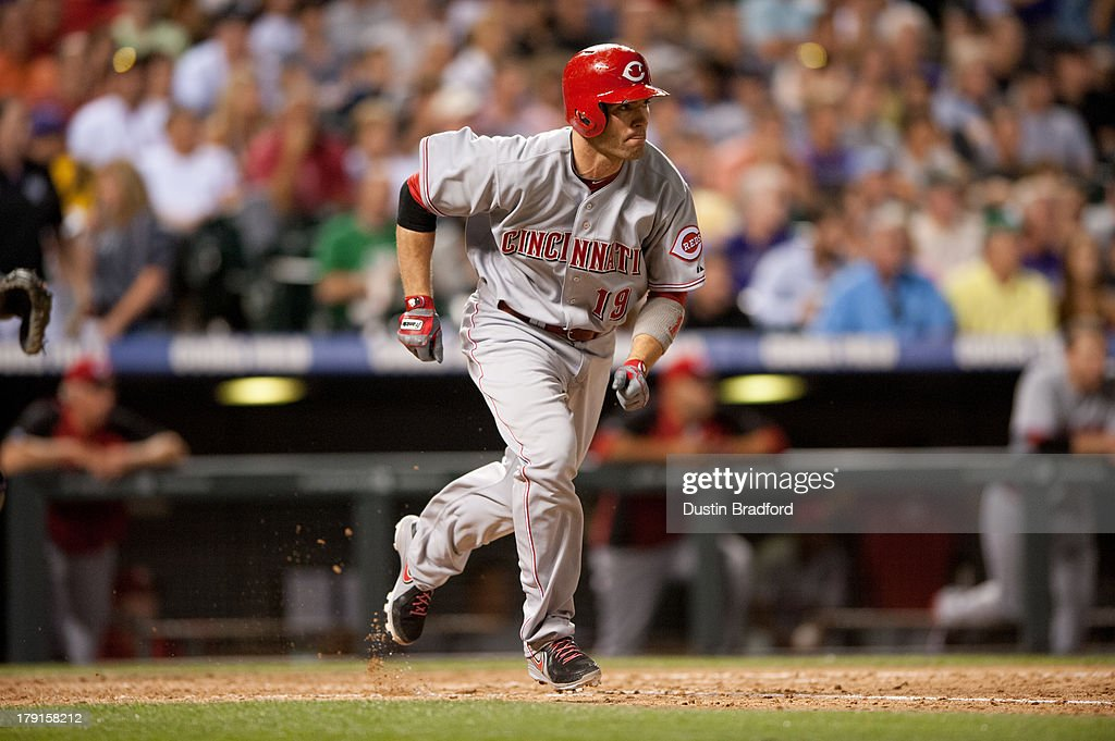 <a gi-track='captionPersonalityLinkClicked' href=/galleries/search?phrase=Joey+Votto&family=editorial&specificpeople=759319 ng-click='$event.stopPropagation()'>Joey Votto</a> #19 of the Cincinnati Reds hustles to first base on a sixth inning RBI single against the Colorado Rockies at Coors Field on August 31, 2013 in Denver, Colorado. The Reds beat the Rockies 8-3.