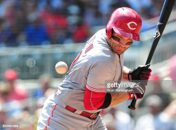 Joey Votto of the Cincinnati Reds is hit by a fifth inning pitch against the Atlanta Braves at SunTrust Park on August 20 2017 in Atlanta Georgia