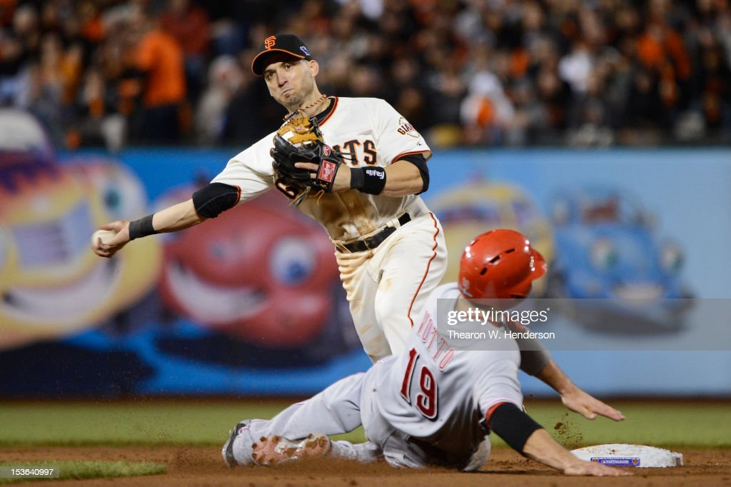 Joey Votto of the Cincinnati Reds is out at second base as Marco Scutaro of the San Francisco Giants turns a double play in the fifth inning of Game...