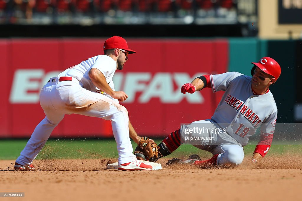 Joey Votto #19 of the Cincinnati Reds is safe at second base against Paul DeJong #11 of the St. Louis Cardinals for a double in the ninth inning at Busch Stadium on September 14, 2017 in St. Louis, Missouri.