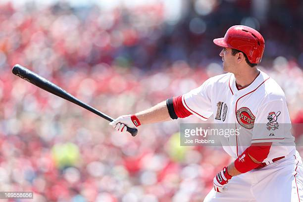 Joey Votto of the Cincinnati Reds is seen wearing special camouflage logos to honor veterans on Memorial Day as he prepares to bat in the first...