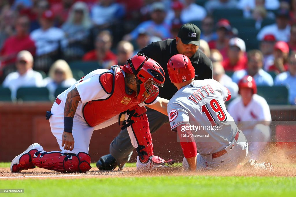Joey Votto #19 of the Cincinnati Reds is tagged out at home by Yadier Molina #4 of the St. Louis Cardinals in the seventh inning at Busch Stadium on September 14, 2017 in St. Louis, Missouri.