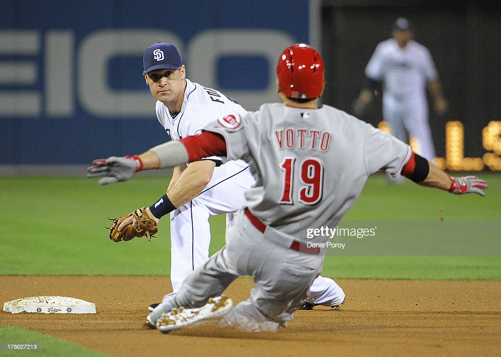 <a gi-track='captionPersonalityLinkClicked' href=/galleries/search?phrase=Joey+Votto&family=editorial&specificpeople=759319 ng-click='$event.stopPropagation()'>Joey Votto</a> #19 of the Cincinnati Reds is tagged out by <a gi-track='captionPersonalityLinkClicked' href=/galleries/search?phrase=Logan+Forsythe&family=editorial&specificpeople=4412508 ng-click='$event.stopPropagation()'>Logan Forsythe</a> #11 of the San Diego Padres as he tries to stretch a single into a double during the seventh inning of a baseball game at Petco Park on July 29, 2013 in San Diego, California.