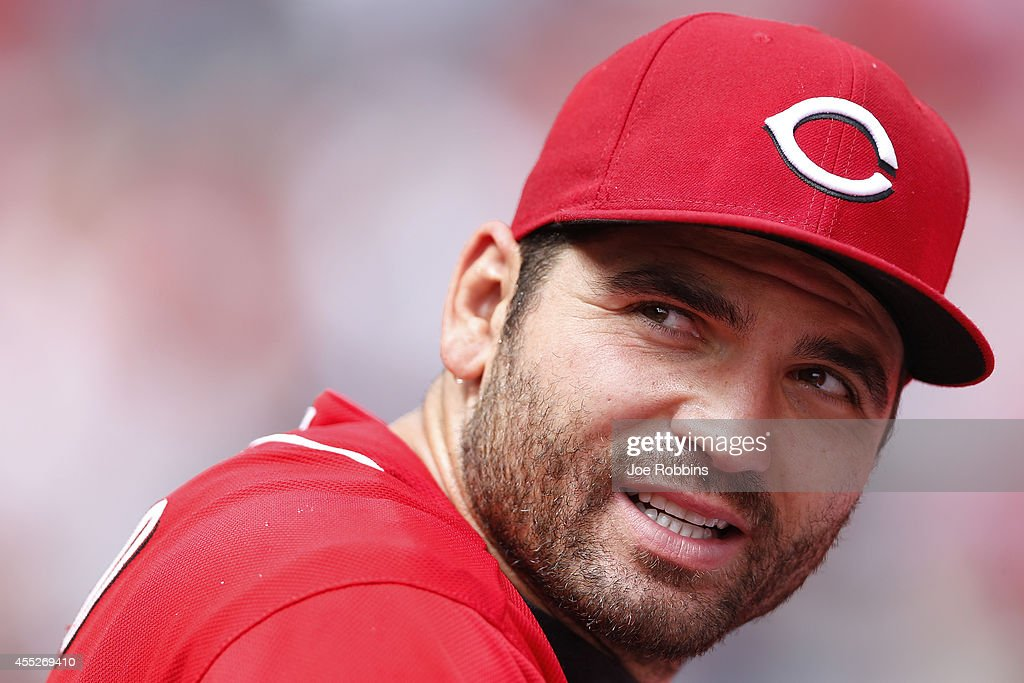 Joey Votto of the Cincinnati Reds looks on from the dugout during the game against the St Louis Cardinals at Great American Ball Park on September 11...
