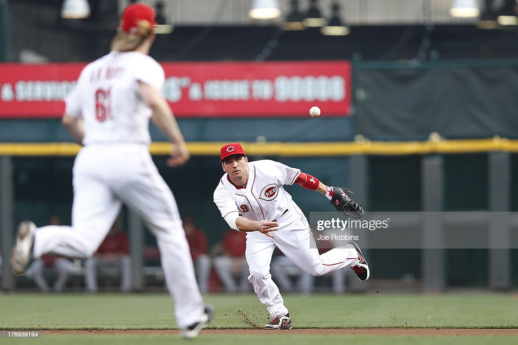 <a gi-track='captionPersonalityLinkClicked' href=/galleries/search?phrase=Joey+Votto&family=editorial&specificpeople=759319 ng-click='$event.stopPropagation()'>Joey Votto</a> #19 of the Cincinnati Reds makes a play at first base against the Arizona Diamondbacks during the game at Great American Ball Park on August 19, 2013 in Cincinnati, Ohio.