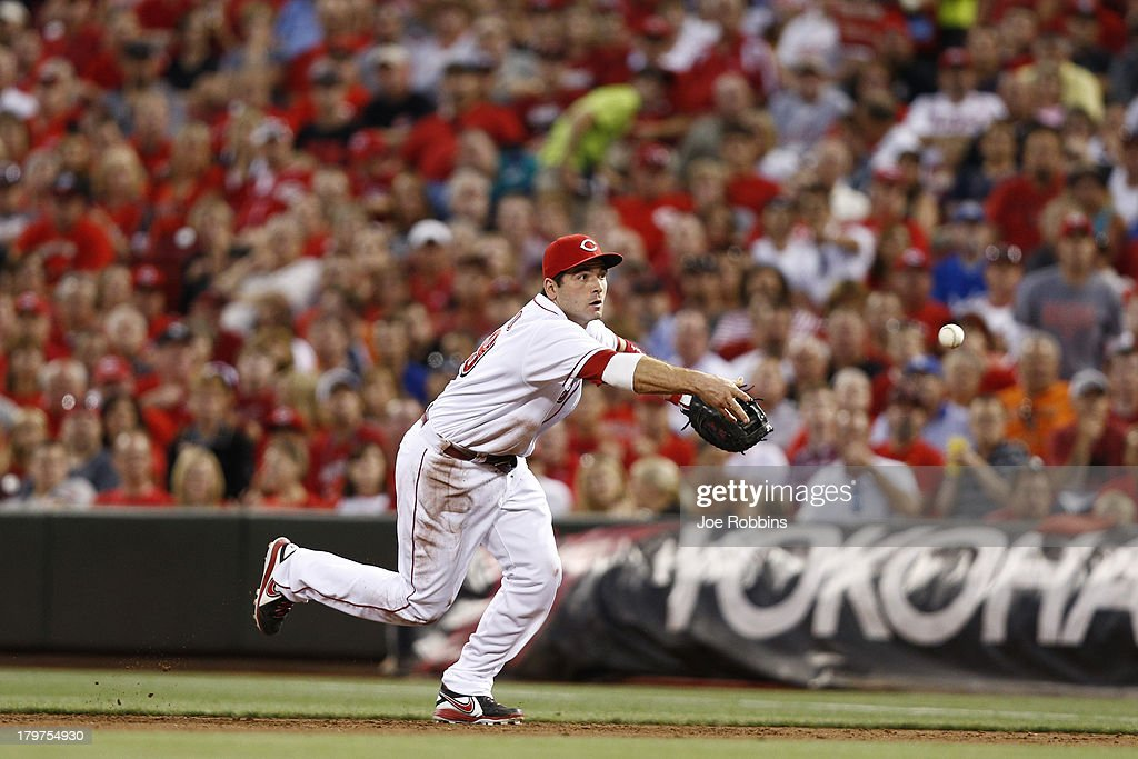 <a gi-track='captionPersonalityLinkClicked' href=/galleries/search?phrase=Joey+Votto&family=editorial&specificpeople=759319 ng-click='$event.stopPropagation()'>Joey Votto</a> #19 of the Cincinnati Reds makes a play at first base against the Los Angeles Dodgers during the game at Great American Ball Park on September 6, 2013 in Cincinnati, Ohio.