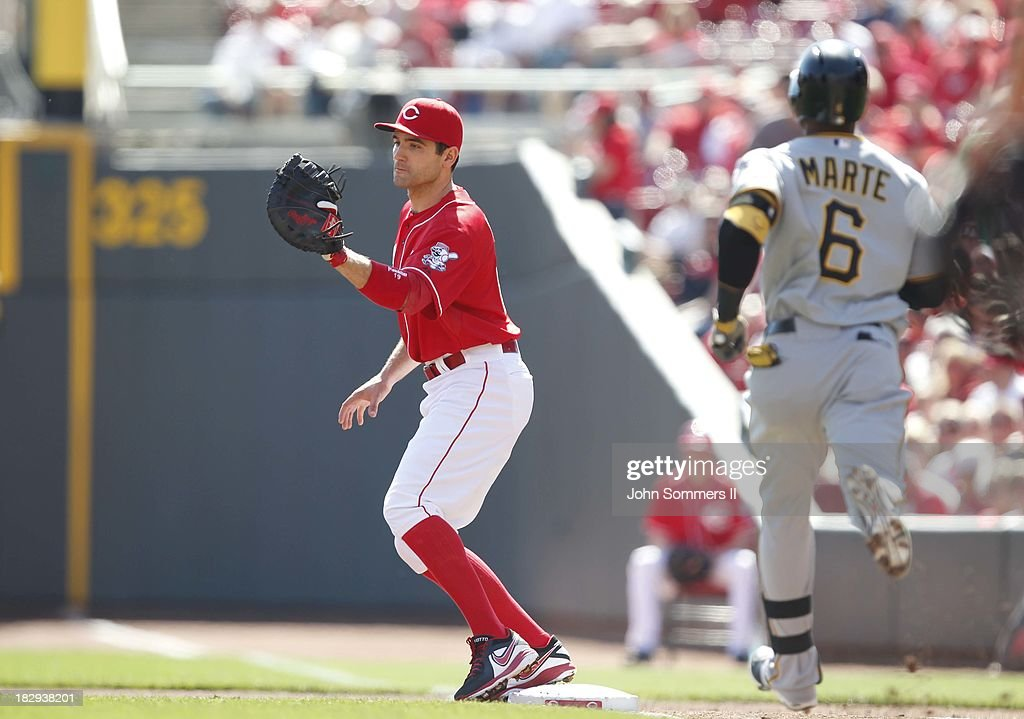 Joey Votto #19 of the Cincinnati Reds makes the play against the Starling Marte #6 of the Pittsburgh Pirates at Great American Ball Park on September 28, 2013 in Cincinnati, Ohio.
