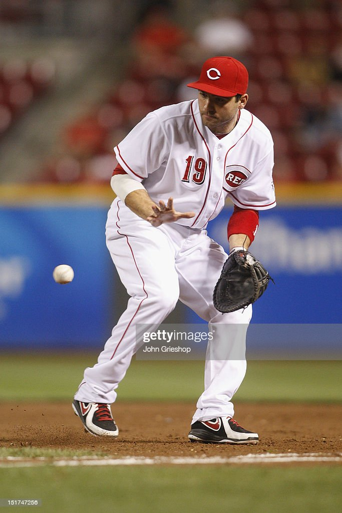 <a gi-track='captionPersonalityLinkClicked' href=/galleries/search?phrase=Joey+Votto&family=editorial&specificpeople=759319 ng-click='$event.stopPropagation()'>Joey Votto</a> #19 of the Cincinnati Reds makes the play at first base during the game against the Pittsburgh Pirates at Great American Ball Park on September 10, 2012 in Cincinnati, Ohio. The Reds defeated the Pirates 4-3 in 14 innings.