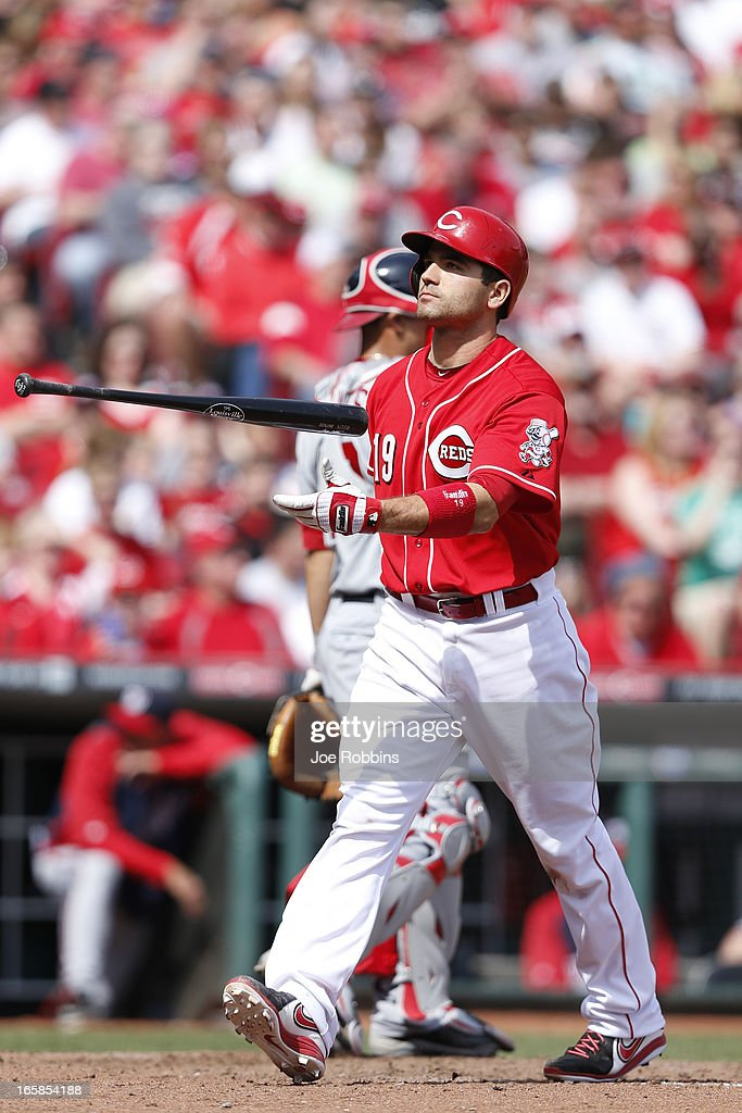 Joey Votto #19 of the Cincinnati Reds reacts after striking out against the Washington Nationals during the game at Great American Ball Park on April 6, 2013 in Cincinnati, Ohio. The Nationals won 7-6 in 11 innings.