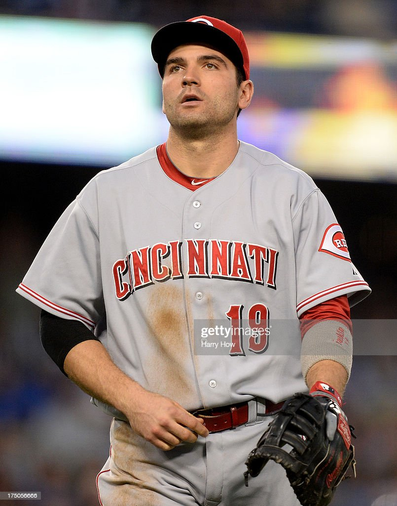 <a gi-track='captionPersonalityLinkClicked' href=/galleries/search?phrase=Joey+Votto&family=editorial&specificpeople=759319 ng-click='$event.stopPropagation()'>Joey Votto</a> #19 of the Cincinnati Reds reacts to a single by Carl Crawford #25 of the Los Angeles Dodgers during the third inning at Dodger Stadium on July 26, 2013 in Los Angeles, California.