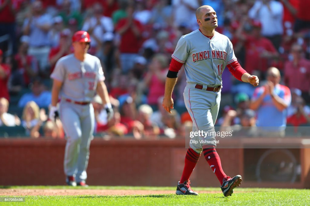 Joey Votto #19 of the Cincinnati Reds returns to the dugout after getting thrown out at home against the St. Louis Cardinals in the seventh inning at Busch Stadium on September 14, 2017 in St. Louis, Missouri.