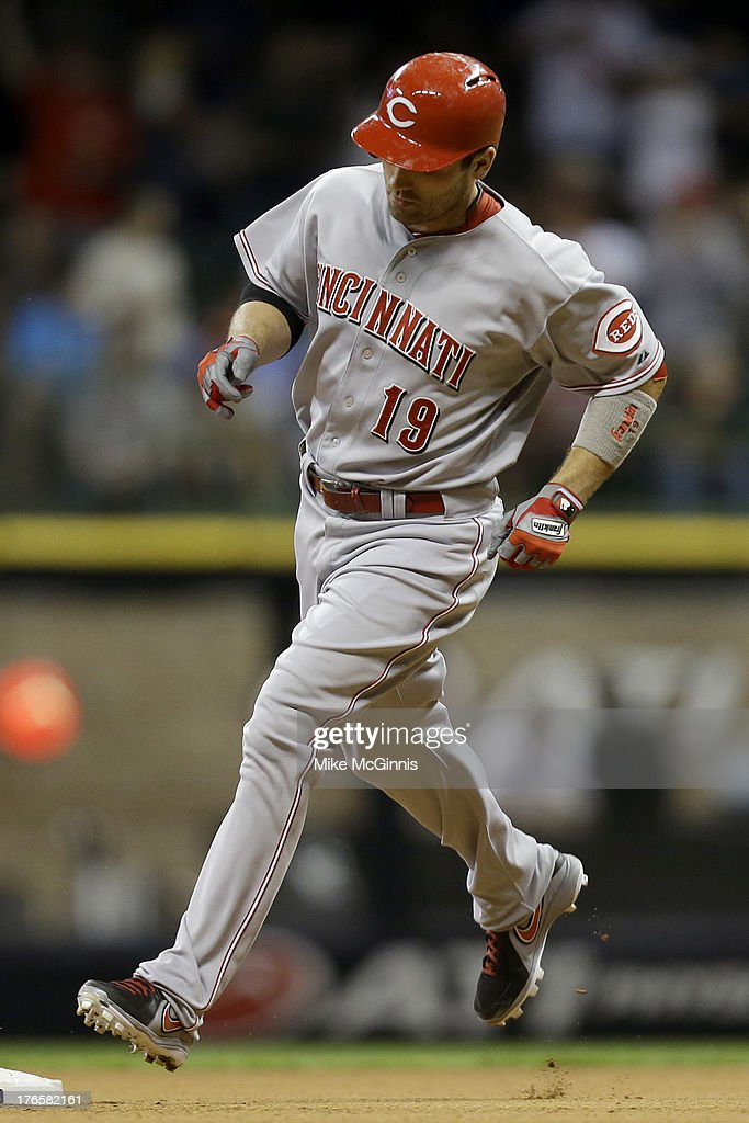 <a gi-track='captionPersonalityLinkClicked' href=/galleries/search?phrase=Joey+Votto&family=editorial&specificpeople=759319 ng-click='$event.stopPropagation()'>Joey Votto</a> #19 of the Cincinnati Reds runs the bases after hitting a solo home run in the top of the sixth inning against the Milwaukee Brewers at Miller Park on August 15, 2013 in Milwaukee, Wisconsin.