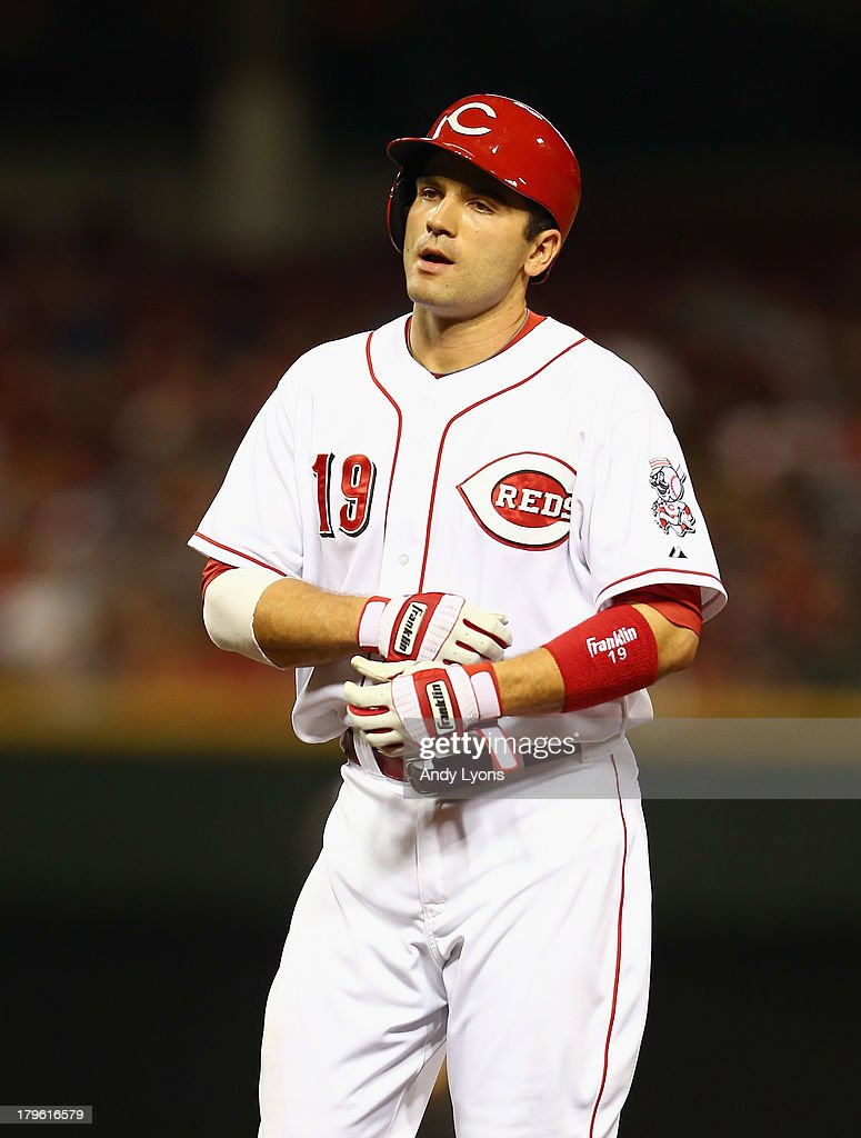 Joey Votto #19 of the Cincinnati Reds walks back to the bench after flying out in the 4th inning during the game against the St. Louis Cardinals at Great American Ball Park on September 5, 2013 in Cincinnati, Ohio.