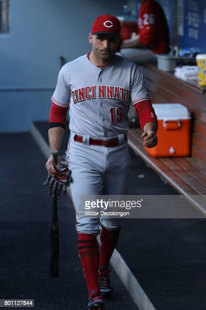 Joey Votto of the Cincinnati Reds walks in the dugout prior to the MLB game against the Los Angeles Dodgers at Dodger Stadium on June 9 2017 in Los...