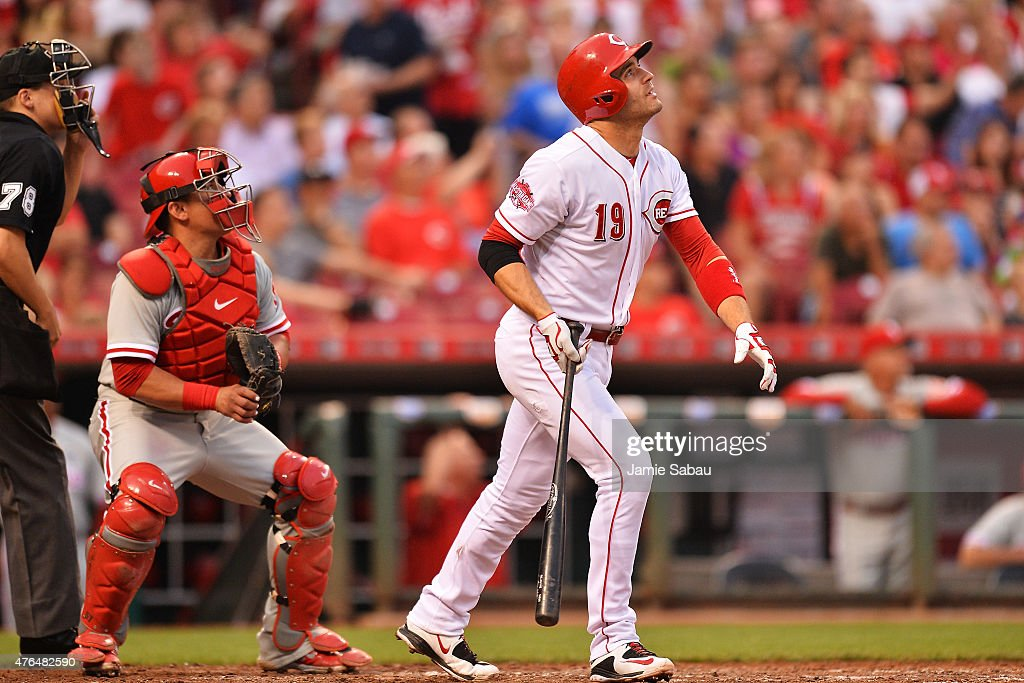 Joey Votto of the Cincinnati Reds watches his fifth inning solo home run sail over the outfield wall against the Philadelphia Phillies at Great...