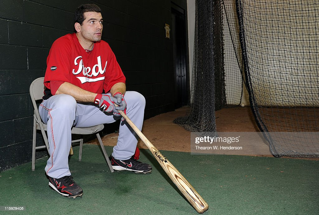 <a gi-track='captionPersonalityLinkClicked' href=/galleries/search?phrase=Joey+Votto&family=editorial&specificpeople=759319 ng-click='$event.stopPropagation()'>Joey Votto</a> #19 of the Cincinnati Reds watches teammates hit in the batting cage before a MLB baseball game between the Cincinnati Reds and the San Francisco Giants June 10, 2011 at AT&T Park in San Francisco, California. The Giants won the game 3-2.