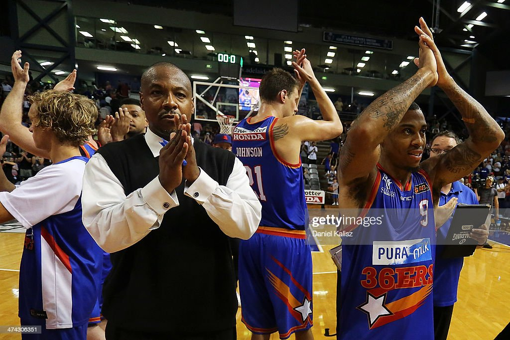 Joey Wright (L) coach of the Sixers celebrates his teams victory with Gary Ervin of the Sixers during the round 19 NBL match between the Adelaide 36ers and the New Zealand Breakers at Adelaide Arena in February 23, 2014 in Adelaide, Australia.