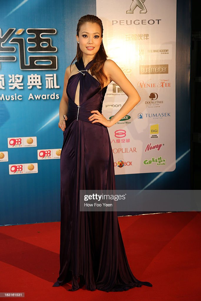 <a gi-track='captionPersonalityLinkClicked' href=/galleries/search?phrase=Joey+Yung&family=editorial&specificpeople=798867 ng-click='$event.stopPropagation()'>Joey Yung</a> of Hong Kong poses during red carpet welcome prior to the start of the 13th Global Chinese Music Awards at Putra Stadium on October 5, 2013 in Kuala Lumpur, Malaysia.
