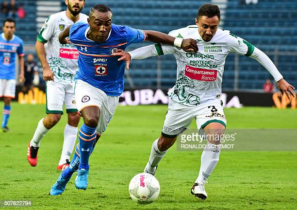 Joffre Guerron of Cruz Azul vies for the ball with William Paredes of Chiapas during their Mexican Clausura tournament football match at the Azul...