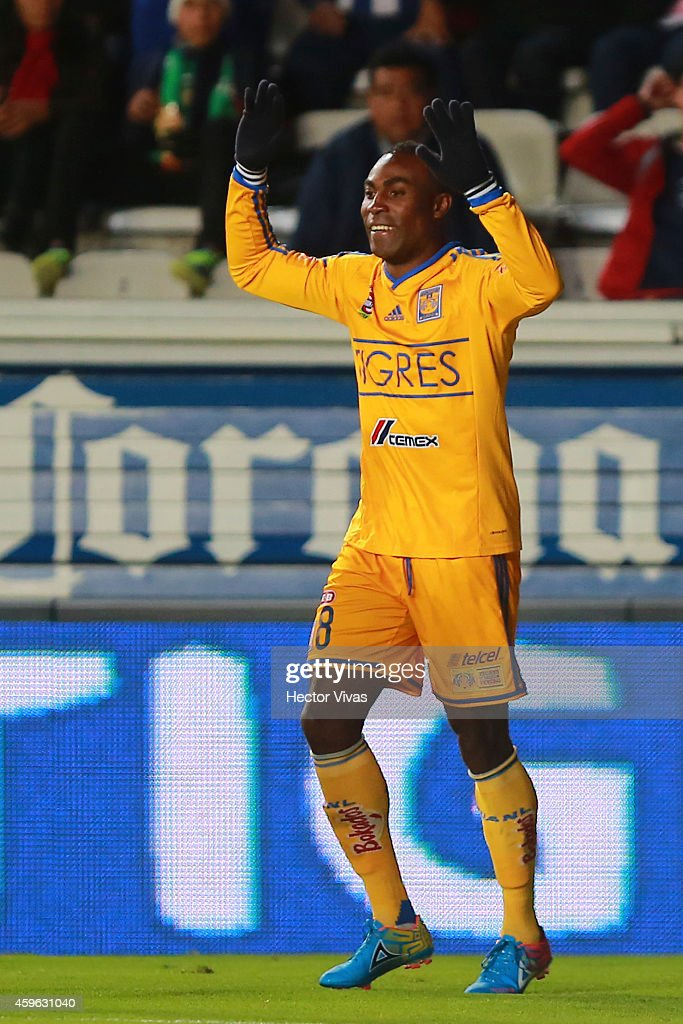 Joffre Guerron of Tigres celebrates after scoring the first goal of his team during a quarterfinal first leg match between Pachuca and Tigres as part...